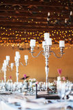Candelabra with candles on decorated wedding reception tables Stock Image