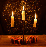 Candelabra with Halloween gifts Royalty Free Stock Photography