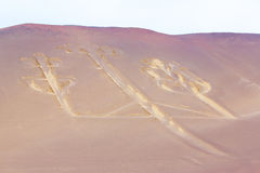 Candelabra, Peru, ancient mysterious drawing in the desert sand, Paracas Park Royalty Free Stock Images