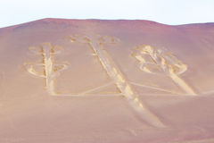 Candelabra, Peru, ancient mysterious drawing in the desert sand, Paracas Park Stock Photo
