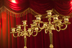 Candelabra with red background Royalty Free Stock Images