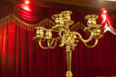 Candelabra with red background Stock Images