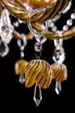 Candelabro de bronze contemporâneo isolado no fundo preto Close-up Crystal Chandelier fotografia de stock royalty free