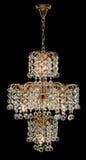Candelabro para o interior da sala de visitas candelabro decorado com os cristais isolados no fundo preto Imagem de Stock