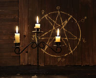 Candelabrum against pentagram background stock image