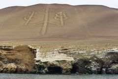 Candelabrum figure in Paracas national park, Peru. Ancient large-scale geoglyph Candelabrum figure in Paracas national park. It is a designated UNESCO World Royalty Free Stock Images