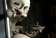 Candelabrum with a Human Skull Stock Photography