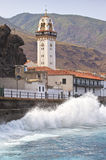 Candelaria church with crushing ocean waves Royalty Free Stock Photos