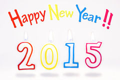 Candele brucianti con il simbolo del nuovo anno 2015 su un bianco Fotografie Stock Libere da Diritti