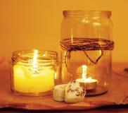 Candele in celecration romantico bruciante di vetro Immagine Stock Libera da Diritti