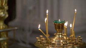 Candele in chiesa stock footage