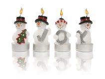 Candele dei pupazzi di neve fotografia stock