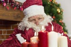 Candele del ` s del nuovo anno e di Santa Claus Fotografia Stock Libera da Diritti