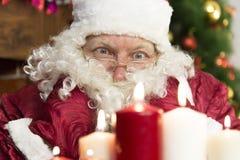 Candele del ` s del nuovo anno e di Santa Claus Fotografia Stock