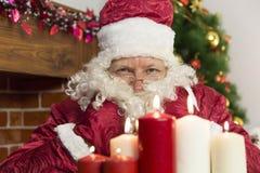 Candele del ` s del nuovo anno e di Santa Claus Fotografie Stock