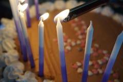 Candele di illuminazione Fotografie Stock