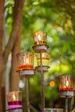 Candele nei supporti di candela di vetro Fotografia Stock