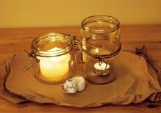 Candele nella celebrazione romantica bruciante di vetro Immagine Stock Libera da Diritti
