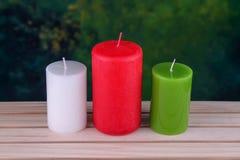 candele sul legno Fotografie Stock