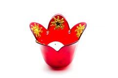 Candelero de cristal rojo de la Navidad con las estrellas del oro Imágenes de archivo libres de regalías