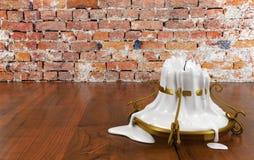 Candelero derretido de la vela y del oro Foto de archivo