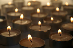 Candels. Several burning candles, distance blur, warm brown color Stock Photo