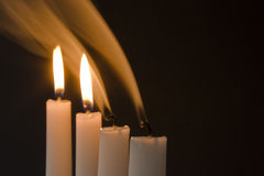 Candels with smoke and wicks Royalty Free Stock Photo