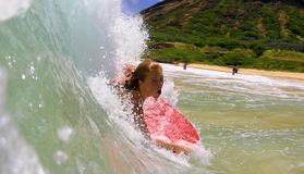 Candice Appleby Surfing a Wave at the Beach. Professional Surfer, Candice Appleby bodyboarding at Sandy Beach in Hawaii Stock Photo
