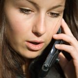 Candid cell phone conversation. Young beautiful brunette female on cell phone Stock Photos
