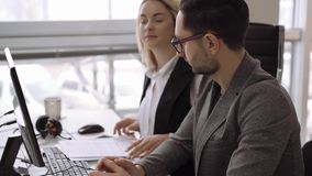 Candid creative busines man and woman discuss project in office. Medium shot. Candid creative busines man and woman discuss project in office 4k footage stock video footage