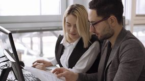 Candid creative busines man and woman discuss project in office. Medium shot. Candid creative busines man and woman discuss project in office 4k footage stock footage