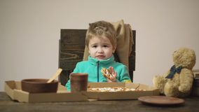 Candid emotions. Authentic moment. Background. Funny kid refuses to eat italian pizza isolated on white. Child is. Capricious, disgusted by food. Junk food. Boy stock video footage