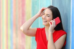 Candid fashion woman in red talking on phone stock images