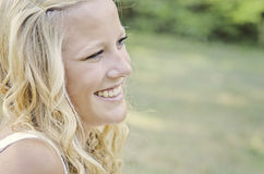 A beautiful blonde high school senior. A female senior portrait shoot smiles at her mom Stock Image