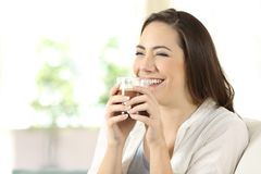Candid girl drinking cocoa shake at home royalty free stock photography