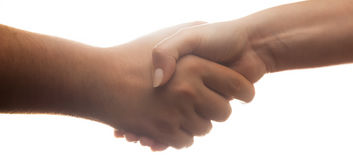 Candid handshake on white background. Strong backlight Royalty Free Stock Photo