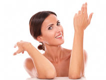 Candid hispanic female gesturing up and smiling Stock Images