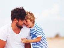 Candid image of father and son laughing, having fun together Stock Image