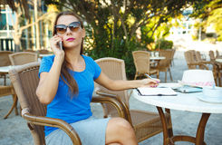 Candid image of a young woman talking on the phone and makes not Stock Images