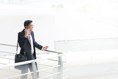 Candid Indian businessman talking on phone Royalty Free Stock Photography