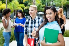 Candid latin american female student with group of students stock photo
