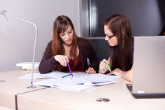 Candid photo of a couple of students studying Stock Photo