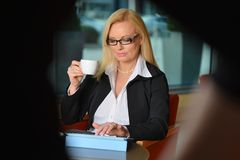 Candid photo of a middle-aged blond businesswoman Royalty Free Stock Photography