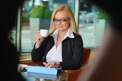 Candid photo of a middle-aged blond businesswoman Royalty Free Stock Images