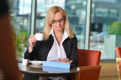 Candid photo of a middle-aged blond businesswoman Stock Photography