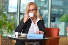 Candid photo of a middle-aged blond businesswoman Stock Photo