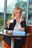 Candid photo of a middle-aged blond businesswoman Royalty Free Stock Photos