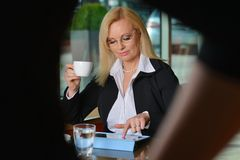 Candid photo of a middle-aged blond businesswoman Royalty Free Stock Photo