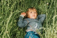 Outdoor portrait of handsome little boy royalty free stock photo