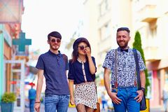 Candid portrait of friends walking the city street Royalty Free Stock Image